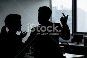 stock-photo-32441636-two-business-people-gesturing-and-arguing-in-the-office